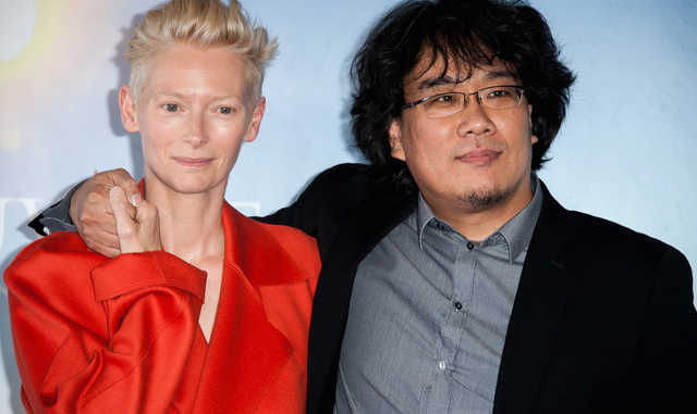 DEAUVILLE, FRANCE - SEPTEMBER 07:  Actress Tilda Swinton and director Bong Joon-Ho (R) pose at a photocall for the film 'Snowpierce' during the 39th Deauville American Film Festival on September 6, 2013 in Deauville, France.  (Photo by Francois Durand/Getty Images)